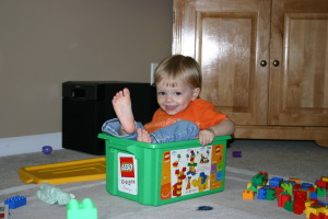 boy in Lego box