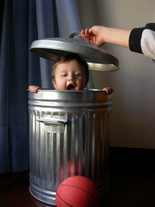 child in a garbage can