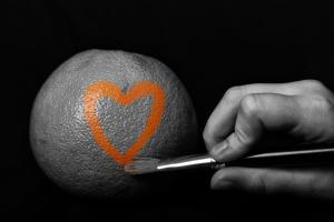 paint heart on an orange